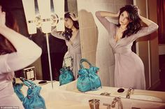 Daisy Lowe smoulders in the new Lancaster Paris campaign as she ruffles her glossy dark hair in front of a mirror wearing a dove grey jersey dress