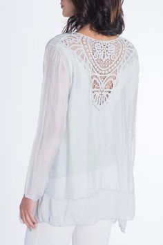 The elegance and ease of this incredible piece are only tow of the fantastic features. The bodice is lined with the same color lightweight piece. Sheer arms the silk layer drops gently lowers on the sides add to the dimension of this top. Embroidered Silk Top by Via Strozzi. Clothing - Tops - Blouses & Shirts Chicago Illinois