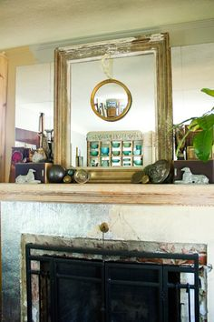 mirror on mirror on mirror, plus silver leafed fireplace- via designsponge