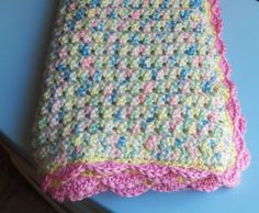 Crochet Attic: Baby Emma's Blanket-Free Pattern - Pretty color idea with variegated yarn for the body of the blanket and then a coordinating color for the edging.