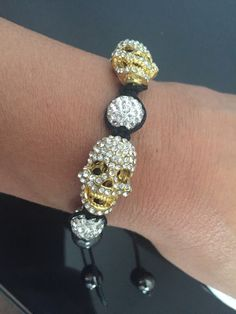 A personal favourite from my Etsy shop https://www.etsy.com/uk/listing/477914599/gold-and-silver-skull-bracelet