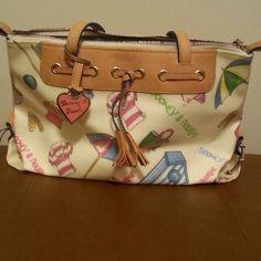 Dooney & Bourke Large tassel zip top. Very cute summer bag with fun designs. Very clean Dooney & Bourke Bags Shoulder Bags