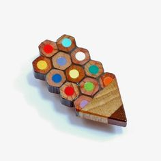 Pencil badge, cunningly made of pencils!