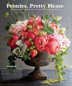 gorgeous peony arrangement in classic urn