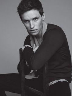 Eddie Redmayne. Cardigan, shirt, and pants by Bottega Veneta. Sweater by Maison Margiela.