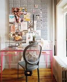 Pretty office with pink desk, vintage Louis chair, black/white herringbone wall