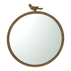 antiqued bird mirror... really hope our new home has a bathroom that needs one of these!