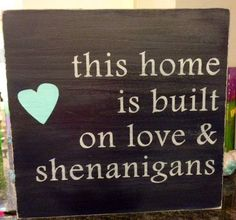 OMG!! I need this!! Black background with red heart!! This house was built on love and shenanigans sign by TimberSigns