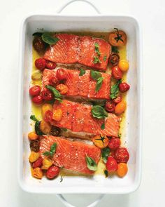Slow-baked Salmon and Cherry Tomatoes, Martha Stewart -- so easy and really tasty; I had to cook the salmon about 25 minutes, next time I'd cook the tomatoes a little less at the beginning Healthy Salmon Recipes, Fish Recipes, Seafood Recipes, Lunch Recipes, Dessert Recipes, Salmon Dishes, Fish Dishes, Main Dishes, Roasted Salmon
