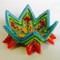 A lovely piece made using fine cylinder glass beads, thread and a needle. Its geometry combines techniques based on the Contemporary Geometric Beadwork (Vol. I & II) known as the fortuneteller bangle. Absolutely colorful bangle in pumpkin, squash, blue, green, yellow, and olivine delicas, comfortable and smooth to wear.  Suitable in any occasion, casual or not, your wrist is destined to catch eyes attention with this little piece of art.  Inner diameter: 18.7cm