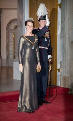 Princess Marie of Denmark stunned in a metallic number at the annual New Year reception at Amalienborg Palace with her husband Prince Joachim.  Photo: Patrick van Katwijk DPA/PA Images