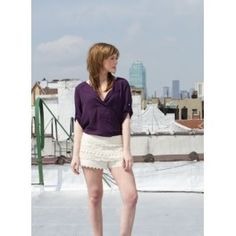 This blouse comes in purple & orange, great staple for spring!