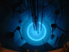 Cherenkov radiation - when heavy particles move through a medium faster than light can move through it.  Also, it's super blue!