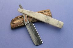 Bill Ellis custom straight razor with San Mai steel and copper inlay on the tang