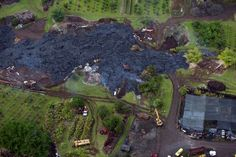 Construction crews try to divert a slow-moving river of lava from Mt. Kilauea from a home in the village of Pahoa, Hawaii October 29, 2014.