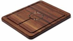 """Snow River Walnut Carving Board with Stainless Steel Gripping Ring and Juice Well, 14 by 18 by 1-Inch by Snow River. $79.45. Reversible, the back side is smooth and flat. Made in USA. Includes removable stainless steel gripper ring. Drip trough captures juices, keeping tables and counters clean. Dimensions  14"""" x 18"""" x 1"""". Snow River's sturdy hardwood cutting board is excellent for large cutting and carving jobs. Made of American Black Walnut, this board looks as good as it perfo..."""