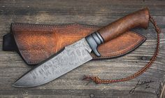Knife with pouch, looks like something a french huntsman would have; Henri