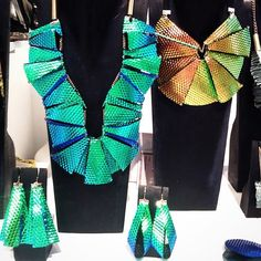 "Shimmering #hologram_""Levels #Necklace""_""Levels #Earrings""_""Fold #Earrings""_""Round #Necklace""_metallic #leather 3D effect."