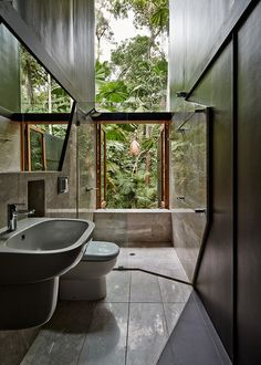 This bathroom in Queensland, Australia, has a full view of the rainforest outside.