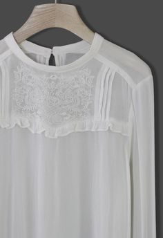 embroidery detail white shirt