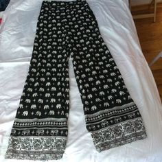 Elephant print loose pants Loose flow elephant print pants. Perfect for ever day. Loose fit and comfortable material. Perfect condition, never worn!  free elephant necklace with purchase  Pants Boot Cut & Flare