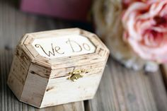 """Alternate to the ring pillow, this rustic wooden wedding ring box says """"We DO"""" on the lid and personalized heart with two initial or date inside. Also it's decorated with green moss like pillow inside which has a natural ribbons for securing the rings."""