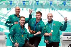 Members of the 4x100 relay team, swimmers Ash Curran, Chris Fydler, Ian Thorpe and Michael Klim, who won gold at the Sydney 2000 Olympic Games, show how they performed on 'air guitars' after winning the final, at the Sydney Olympic Park Aquatic Centre, Homebush.