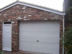 Garage made from reclaimed brick.
