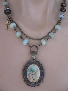 RESERVED  Divine Embrace vintage religious medal by OhMyGypsySoul, $72.00 - with diffent pendant?