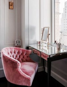 Mirrored vanity and pink velvet button back bucket chair...yummy