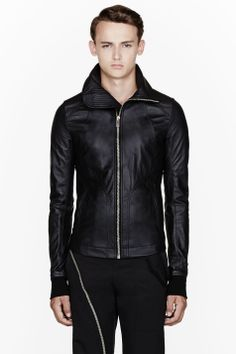 RICK OWENS //  Black leather high-neck Intarsia jacket  32232M032005  Buffed leather jacket in black. Stand collar. Zip closure and welt pockets at front. Welt pockets. Fully lined. Tonal stitching. Ribbed knit sleeve cuffs. Shell: 100% lamb leather. Ribbed knit: 100% wool. Front lining: 100% cotton. Back and sleeves lining: 100% cupro. Specialty cleaners. Made in Italy.  $2175 CAD
