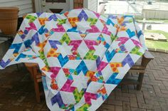 Star flower quilt pattern by fons  porter Love the colours in this quilt.  It reminds me of summer