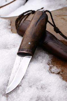 Roman Stoklasa Knives. Love the handle on this one. Carved off some of the butt and tooled it, pretty sweet.