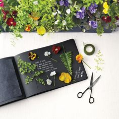 I love this DIY press flower guestbook! Fabulous idea!