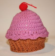 Sweet newborn muffin-with-frosting-and-cherry hat :)