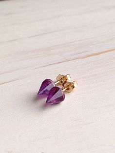 Tiny edgy gemstone spike studs in sparkling amethyst with gold filled findings.    Stone size 6mm    in stock: International shipping except Canada