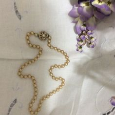 Antique pearls Antique pearls with gold and rhinestone clasp. 20 inches long. Hand knots between each pearl. Solid craftsmanship – no loose pearls. Beautiful color. Jewelry Necklaces