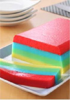 Rainbow JELL-O Dessert Slices – Looking for a festive and easy recipe? This colorful dessert will do the trick!