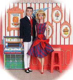 Vintage 1964 Ken doll wearing 'Victory Dance.' Original 1966 Barbie doll with bendable legs wearing 'Beau Time.' Original 1964 'Barbie Goes to College' play set.
