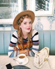 @syd.hoff enjoying coffee in a striped LOFT sweater