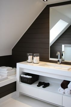 Masculine bathroom. Love the black and white. So chic.