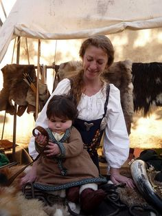 Viking mother and baby by Esther Moliné, via Flickr