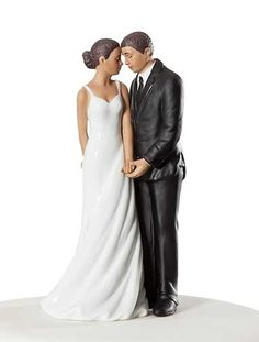 This lovely fine porcelain African-American wedding cake topper shows the bride sharing an intimate moment together on their wedding day. This will make a beautiful addition for your guestbook table, or to crown the top of your wedding cake. Handpainted. <br /> <br />Also available in Caucasian. <br />