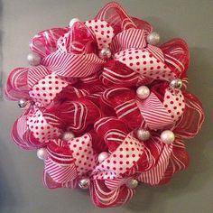 This red and white polka dot and stripes deco mesh Christmas wreath is created on