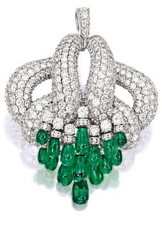 EMERALD AND DIAMOND PENDANT Of bombé ribbon design, pavé-set with brilliant-cut diamonds together weighing approximately 28.00 carats, suspending twenty emerald drops together weighing approximately 20.00 carats, mounted in 18 karat white gold.
