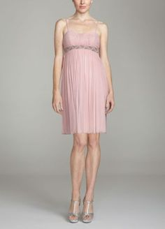 Redefine short and sweet in this sassy bridesmaids dress!  Pleated skirt and gathering on bustline provide gorgeous accents.  Colored beads along the waist are a beautiful lesson in complementary contrast.  Spaghetti straps and sweetheart neckline are romantic and delicate.  Fully Lined. Dry Clean Only.