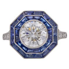 Tiffany & Co. Sapphire Diamond Platinum Octagonal Ring | From a unique collection of vintage cocktail rings at https://www.1stdibs.com/jewelry/rings/cocktail-rings/