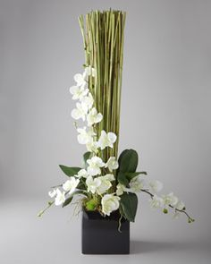 bamboo and orchid floral arrangement