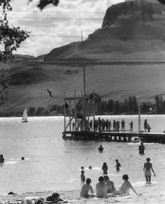 Kids diving off of the diving platform and pier at the Kalamalka Lake beach wharf, circa Photo courtesy of the Greater Vernon Museum and Archives, Vernon BC Canada. Lake Beach, Beach Fun, Vernon Bc, Historical Pictures, History Facts, British Columbia, Diving, Vancouver, Museum
