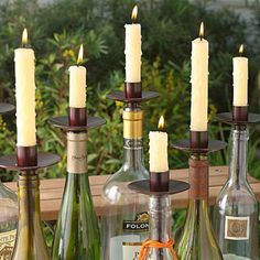 Turn wine bottles into decorative centerpieces with Bottelabra candleholders. Great for outdoor parties  or wine-and-cheese soirées! Find them at Hands Jewelers ($10), along with multi-colored taper candles.